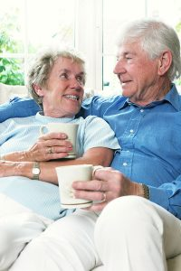 Senior couple enjoying a cup of coffee